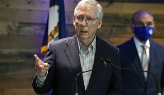 Senate Minority Leader Mitch McConnell, R-Ky., speaks during a news conference at Kroger Field in Lexington, Ky., Monday, April 5, 2021. (AP Photo/Timothy D. Easley)