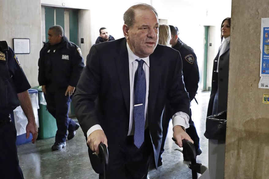 """FILE — In this Feb. 21, 2020 file photo, Harvey Weinstein arrives at a Manhattan court as jury deliberations continue in his rape trial, in New York. More than a year after Weinstein's rape conviction, his lawyers are demanding a new trial, arguing in court papers Monday, April 5, 2021, that the landmark #MeToo prosecution that put him behind bars was buoyed by improper rulings from a judge who was """"cavalier"""" in protecting the disgraced movie mogul's right to a fair trial. (AP Photo/Richard Drew, File)"""