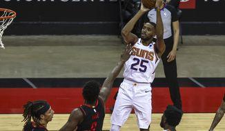 Phoenix Suns forward Mikal Bridges (25) shoots against the Houston Rockets during the fourth quarter of an NBA basketball game in Houston, Monday, April 5, 2021. (Troy Taormina/Pool Photo via AP)