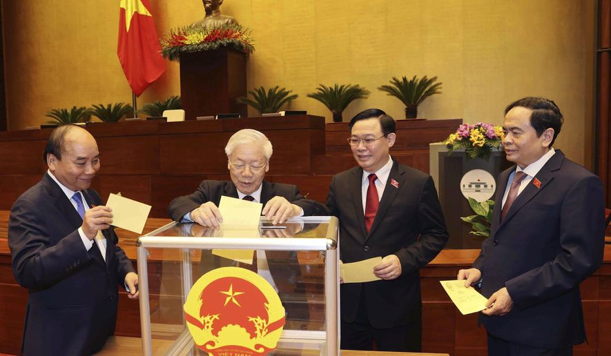 Vietnamese leaders cast ballot to elect new Prime Minister, from left, President Nguyen Xuan Phuc, Communist General Secretary Nguyen Phu Trong, Chairman of National Assembly Vuong Dinh Hue and newly elected Prime Minister Pham Minh Chinh in Hanoi, Vietnam on Monday, April 5, 2021. Vietnam's legislature voted Monday to make Pham Minh Chinh, a member of the Communist party's central committee for personnel and organization, the country's next prime minister. Outgoing Prime Minister Nguyen Xuan Phuc was appointed the new president.(Nguyen Phuong Hoa/VNA via AP)