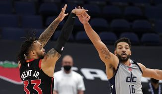 Toronto Raptors guard Gary Trent Jr. (33) shoots over Washington Wizards forward Anthony Gill (16) with the game-winning three-point basket during the second half of an NBA basketball game Monday, April 5, 2021, in Tampa, Fla. (AP Photo/Chris O'Meara)