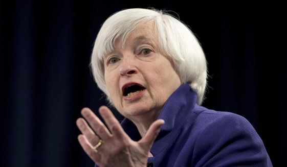 In this Dec. 13, 2017, file photo, Federal Reserve Chair Janet Yellen speaks during a news conference following the Federal Open Market Committee meeting in Washington. Yellen on Monday, April 5, 2021, urged the adoption of a minimum global corporate income tax, an effort to offset any disadvantages that might arise from the Biden administration's proposed increase in the U.S. corporate tax rate. (AP Photo/Carolyn Kaster, File)