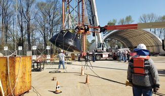 NASA engineers on Tuesday dropped a model capsule of the Orion spacecraft into the Hydro Impact Basin at the Langley Research Center as a water landing test. The Orion spacecraft is scheduled to carry astronauts, including the first female, to the moon's surface in 2024 on the Artemis III flight. (Courtesy of NASA)