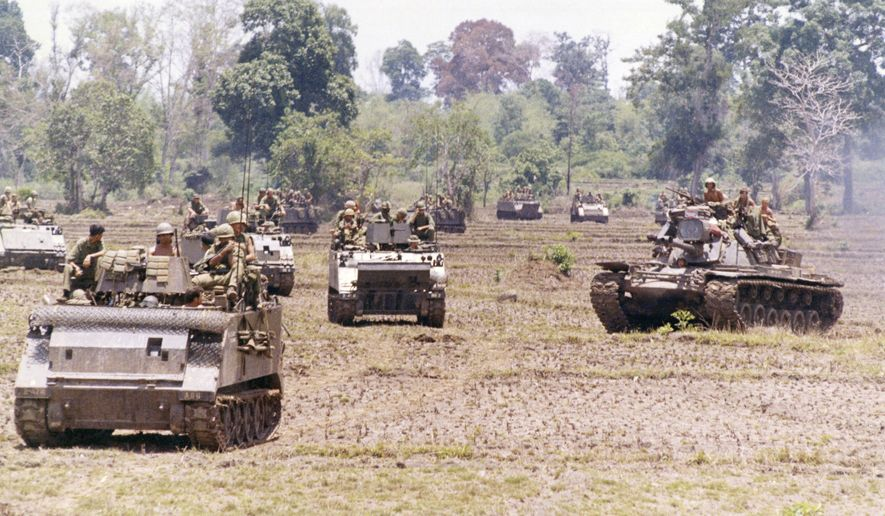 United States armored unit moves north into Cambodia, 10 miles north of Katum base in South Vietnam. Unit is 2/47 Infantry, A-Company, the first to cross the border into Cambodia on May 1, 1970, following orders from U.S. President Richard Nixon to search out Communist High Command Headquarters. (AP Photo/Henri Huet) ** FILE **