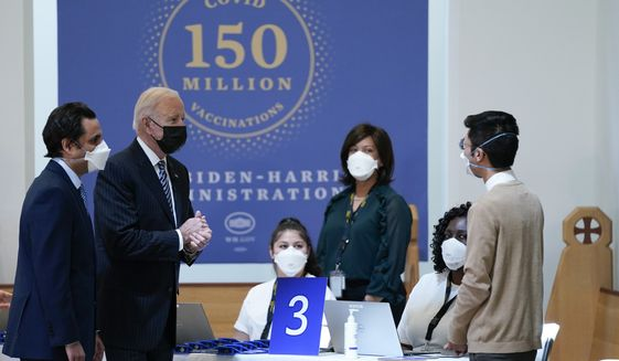 President Joe Biden speaks with health care workers as he visits a vaccination site at Virginia Theological Seminary, Tuesday, April 6, 2021, in Alexandria, Va. (AP Photo/Evan Vucci)