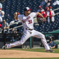Max Scherzer winds back to throw a pitch in the Washington Nationals' opening day game Tuesday. Scherzer threw six innings, allowing four homers.