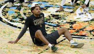 Baylor guard MaCio Teague celebrates on the court after the championship game against Gonzaga in the men's Final Four NCAA college basketball tournament, Monday, April 5, 2021, at Lucas Oil Stadium in Indianapolis. Baylor won 86-70. (AP Photo/Darron Cummings)