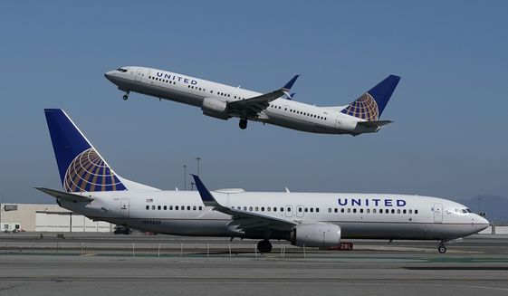 In this Oct. 15, 2020, file photo, a United Airlines airplane takes off over a plane on the runway at San Francisco International Airport in San Francisco. United Airlines says it will train 5,000 pilots at its own academy in this decade, and it hopes that half of them will be women or people of color. United said Tuesday, April 6, 2021, it is now taking applications for the academy in Arizona, including from people who have no flying experience. (AP Photo/Jeff Chiu, File)