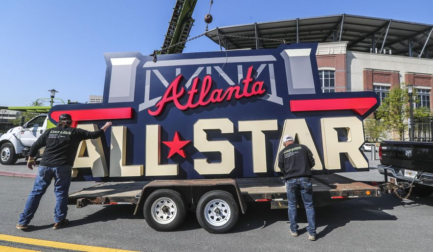 Workers load an All-Star sign onto a trailer after it was removed from Truist Park in Atlanta, Tuesday, April 6, 2021. Major League Baseball plans to relocate the All-Star Game to Coors Field in Denver after pulling this year's Midsummer Classic from Atlanta over objections to sweeping changes to Georgia's voting laws, according to a person familiar with the decision. (John Spink/Atlanta Journal-Constitution via AP) ** FILE **