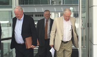 FILE - In this April 30, 2018, file photo, are Backpage.com founders James Larkin, left, and Michael Lacey, right, as they leave federal court in Phoenix in a case in which they are charged with facilitating prostitution. A federal appeals court on April 5, 2021, rejected a request by the former operators of Backpage.com to prevent a judge from presiding over their trial because of statements made by the judge's husband, Arizona Attorney General Mark Brnovich, about the now-shuttered classified ad site. Lacey, Larkin and four other former site employees have pleaded not guilty to charges. (AP Photo/Jacques Billeaud, File)