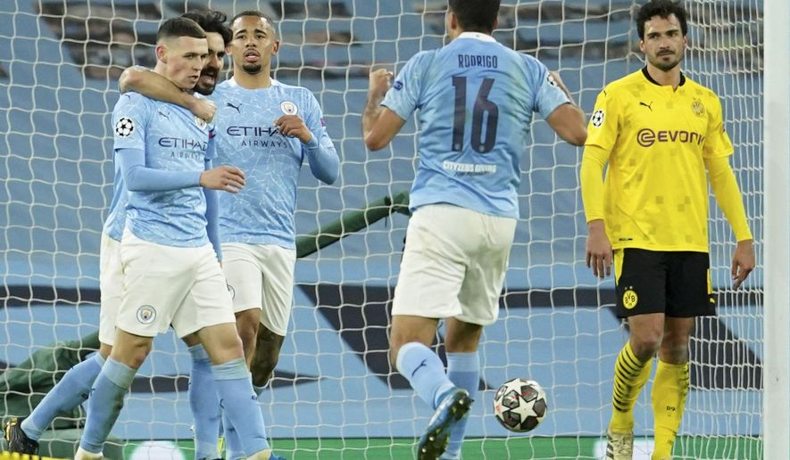 Manchester City's Phil Foden celebrates after scoring his side's second goal during the Champions League, first leg, quarterfinal soccer match between Manchester City and Borussia Dortmund at the Etihad stadium in Manchester, Tuesday, April 6, 2021. (AP Photo/Dave Thompson)
