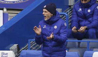 Chelsea manager Thomas Tuchel gives instructions during the English Premier League soccer match between Chelsea and West Bromwich Albion at Stamford Bridge stadium in London, England, Saturday, April 3, 2021.(John Walton/Pool via AP)