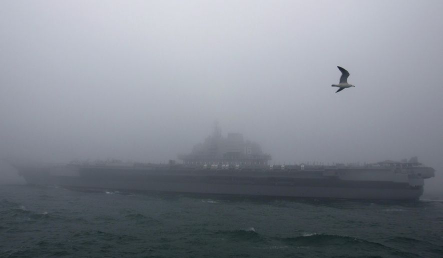 FILE - In this April 23, 2019, file photo, the Chinese People's Liberation Army (PLA) Navy aircraft carrier Liaoning participates in a naval parade to commemorate the 70th anniversary of the founding of China's PLA Navy in the sea near Qingdao in eastern China's Shandong province. China says it is holding naval drills involving the battlegroup of the aircraft carrier Liaoning in waters near Taiwan. (AP Photo/Mark Schiefelbein, Pool, File)