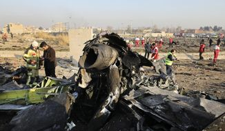 In this Jan. 8, 2020, file photo, debris at the scene where a Ukrainian plane crashed in Shahedshahr southwest of the capital Tehran, Iran. Iranian media are quoting the outgoing military prosecutor of Tehran as saying that 10 officials have been indicted for the 2020 shootdown of a Ukrainian passenger plane. (AP Photo/Ebrahim Noroozi, File)