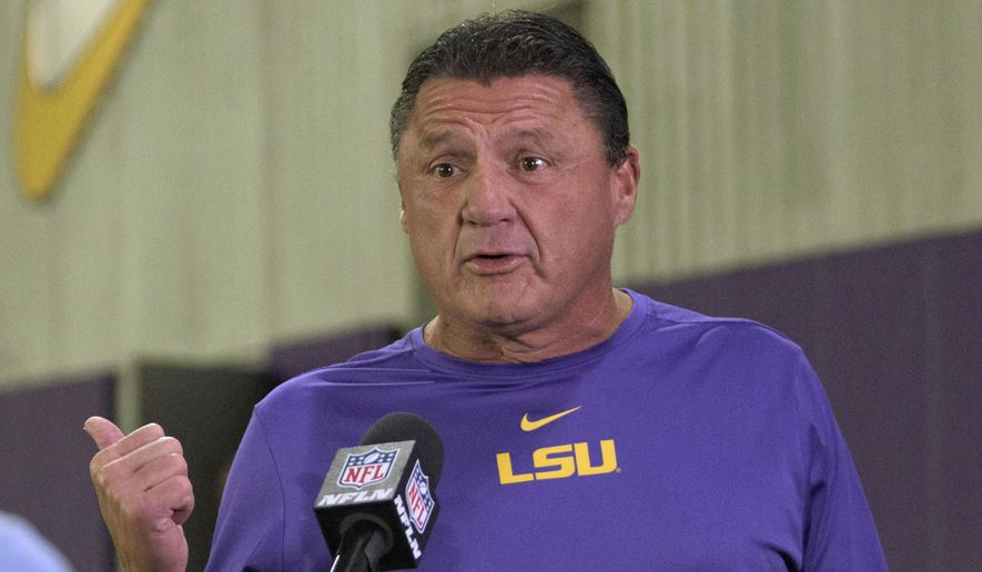 LSU head coach Ed Orgeron is interviewed during an NFL Pro Day at LSU in Baton Rouge, La., Wednesday, March 31, 2021. (AP Photo/Matthew Hinton) **FILE**
