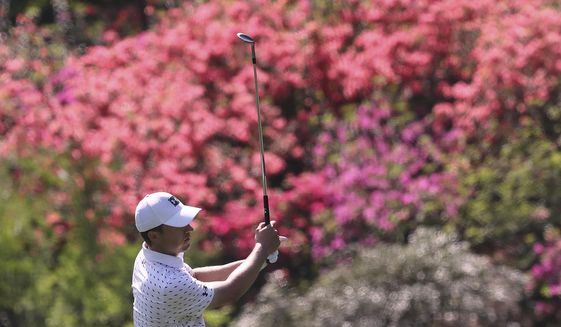 The azaleas are beginning to pop as Jordan Spieth chips to the 13th green during his practice round for the Masters at Augusta National Golf Club on Tuesday, April 6, 2021, in Augusta, Ga. (Curtis Compton/Atlanta Journal-Constitution via AP) **FILE**