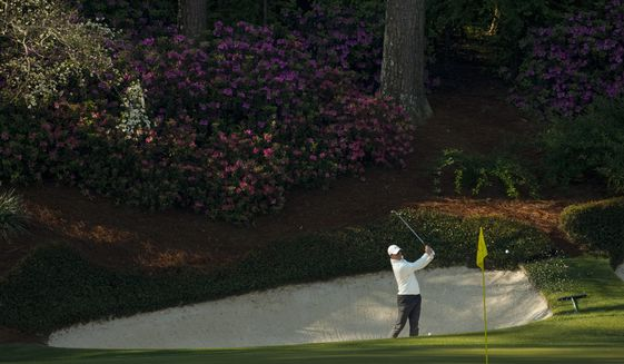Rory McIlroy, of Northern Ireland, hits from the bunker on the 13th hole during a practice round for the Masters golf tournament on Tuesday, April 6, 2021, in Augusta, Ga. (AP Photo/David J. Phillip)
