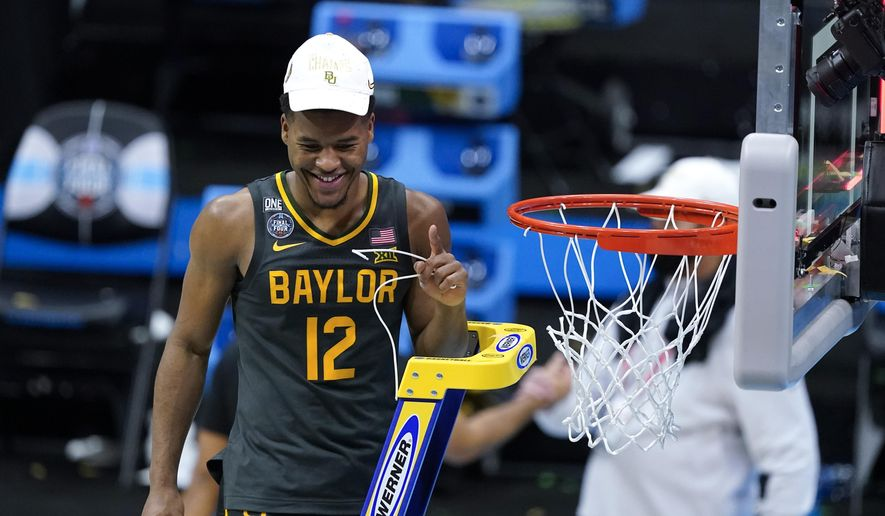 Baylor guard Jared Butler cuts down the net after the championship game against Gonzaga in the men's Final Four NCAA college basketball tournament, Monday, April 5, 2021, at Lucas Oil Stadium in Indianapolis. Baylor won 86-70. (AP Photo/Darron Cummings). **FILE**