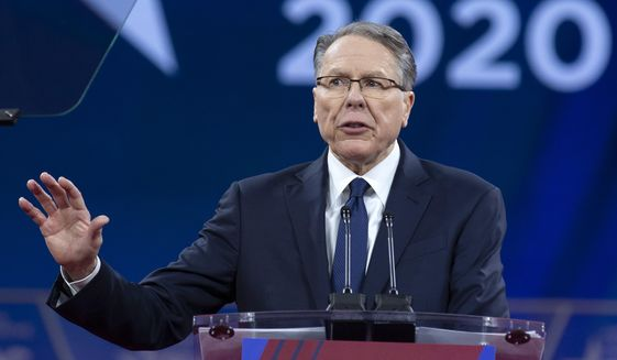 FILE - In this Saturday, Feb. 29, 2020, file photo, National Rifle Association Executive Vice President and CEO Wayne LaPierre speaks at the Conservative Political Action Conference, CPAC 2020, at the National Harbor, in Oxon Hill, Md. After school shootings that left dozens dead in recent years, LaPierre said the resulting outrage put him in such danger that he sought shelter aboard a friend's 108-foot yacht. (AP Photo/Jose Luis Magana, File)
