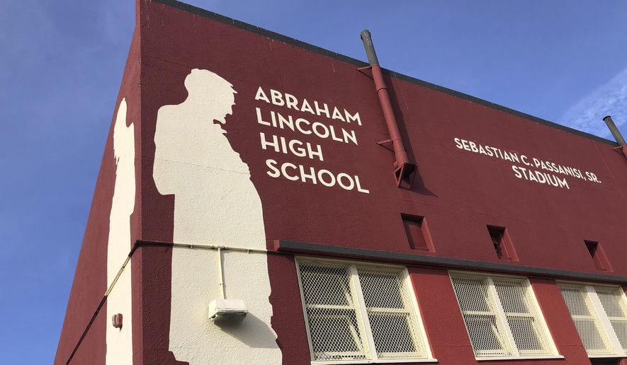 Abraham Lincoln High School is seen in San Francisco, on Jan. 27, 2021. The embattled San Francisco school board is poised to reverse a decision to rename 44 schools in an effort to avoid costly litigation and tone down national criticism. In a Tuesday, April 6, 2021, meeting, the board will vote on a resolution to rescind a controversial January decision to rename schools and revisit the matter after all students have returned full-time to in-person learning. (AP Photo/Haven Daley)