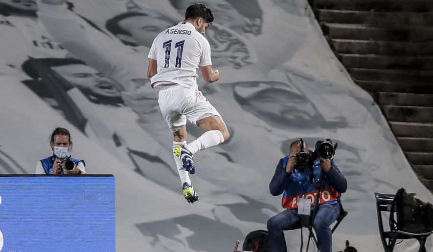 Real Madrid's Marco Asensio celebrates after scoring his team second goal during the Champions League quarterfinal first leg, soccer match between Real Madrid and Liverpool at the Alfredo di Stefano stadium in Madrid, Spain, Tuesday, April 6, 2021. (AP Photo/Manu Fernandez)