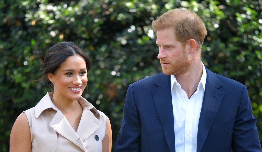 In this Oct. 2, 2019, file photo, Britain's Prince Harry and Meghan Markle appear at the Creative Industries and Business Reception at the British High Commissioner's residence in Johannesburg. (Dominic Lipinski/Pool via AP, File)