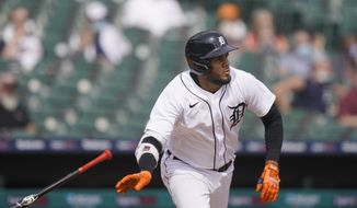 Detroit Tigers' Jeimer Candelario watches his run-scoring double during the fifth inning of a baseball game against the Minnesota Twins, Tuesday, April 6, 2021, in Detroit. (AP Photo/Carlos Osorio)