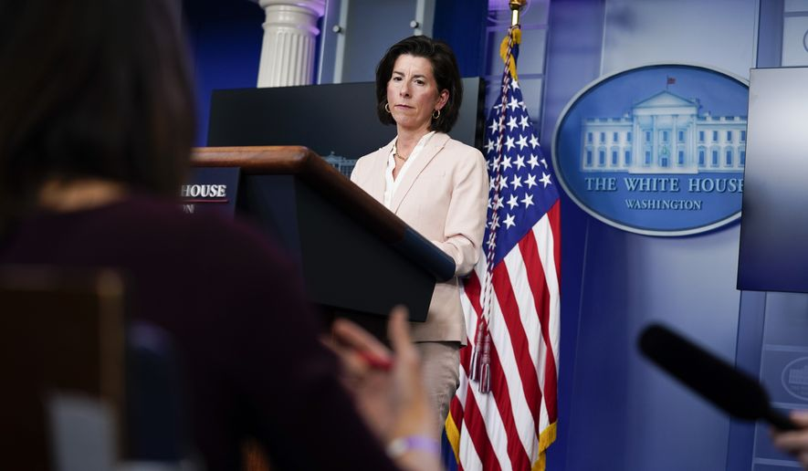 Commerce Secretary Gina Raimondo listens to a question during a press briefing at the White House, Wednesday, April 7, 2021, in Washington. (AP Photo/Evan Vucci)