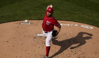 Washington Nationals starting pitcher Stephen Strasburg throws during the third inning of the second baseball game of a doubleheader at Nationals Park, Wednesday, April 7, 2021, in Washington. (AP Photo/Alex Brandon)