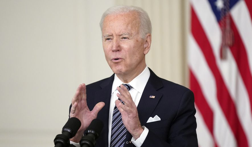 In this March 25, 2021, photo, President Joe Biden speaks about the COVID-19 relief package in the State Dining Room of the White House in Washington. (AP Photo/Patrick Semansky) **FILE**