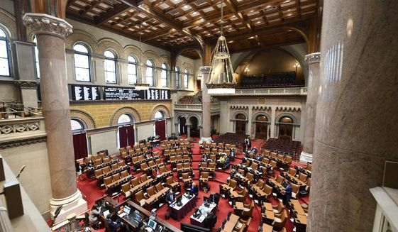Members of the New York Assembly debate budget bills during a legislative session in the Assembly Chamber at the state Capitol, Wednesday, April 7, 2021, in Albany, N.Y. (AP Photo/Hans Pennink)