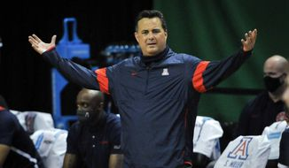 Arizona head coach Sean Miller questions a call during the second half of an NCAA college basketball game against Arizona in Eugene, Ore., in this Monday, March 1, 2021, file photo. Arizona has parted ways with men's basketball coach Sean Miller as the program awaits its fate in an NCAA infractions investigation, a person with knowledge of the situation told The Associated Press. The person told the AP on condition of anonymity Wednesday, April 7, 2021, because no official announcement has been made. (AP Photo/Andy Nelson, File) **FILE**