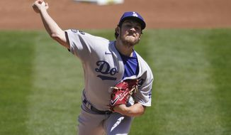 Los Angeles Dodgers pitcher Trevor Bauer throws against the Oakland Athletics during the first inning of a baseball game in Oakland, Calif., Wednesday, April 7, 2021. (AP Photo/Jeff Chiu)