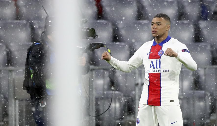 PSG's Kylian Mbappe celebrates after scoring the opening goal of his team during the Champions League quarterfinal soccer match between Bayern Munich and Paris Saint Germain in Munich, Germany, Wednesday, April 7, 2021. (AP Photo/Matthias Schrader)