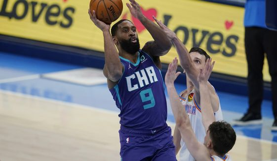 Charlotte Hornets guard Brad Wanamaker (9) shoots over Oklahoma City Thunder guard Ty Jerome, right, in the second half of an NBA basketball game Wednesday, April 7, 2021, in Oklahoma City. (AP Photo/Sue Ogrocki)