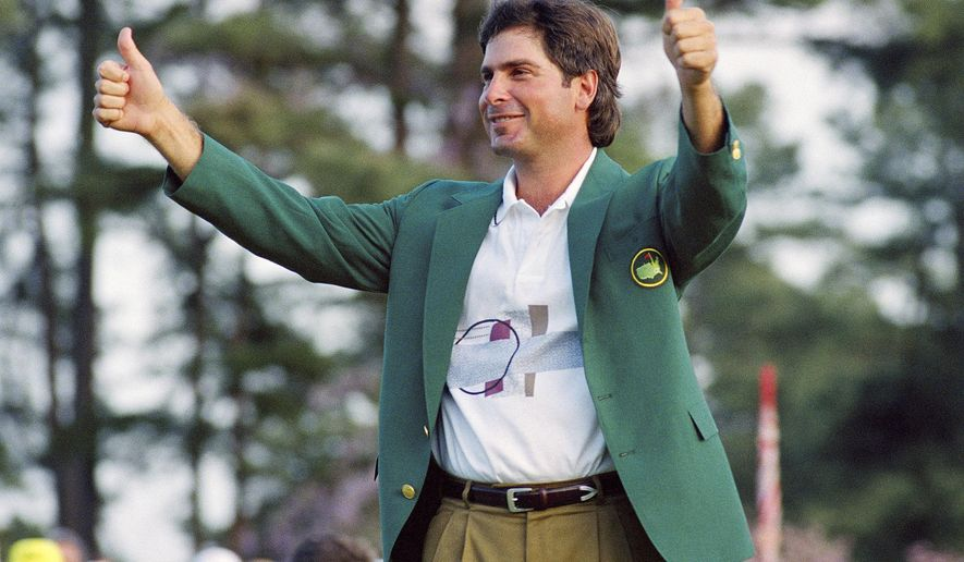 FILE - In this April 12, 1992, file photo, Fred Couples gives the thumbs-up after getting his traditional green jacket after winning the 1992 Masters golf tournament at the Augusta National Golf Club in Augusta, Ga. Couples brought the driver he used that week to Augusta National for a display of clubs used by Masters champions. (AP Photo/Lenny Ignelzi, File)