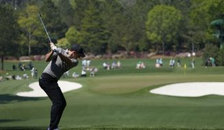 Rory McIlroy, of Northern Ireland, tees off on the fourth hole during a practice round for the Masters golf tournament on Wednesday, April 7, 2021, in Augusta, Ga. (AP Photo/Gregory Bull)