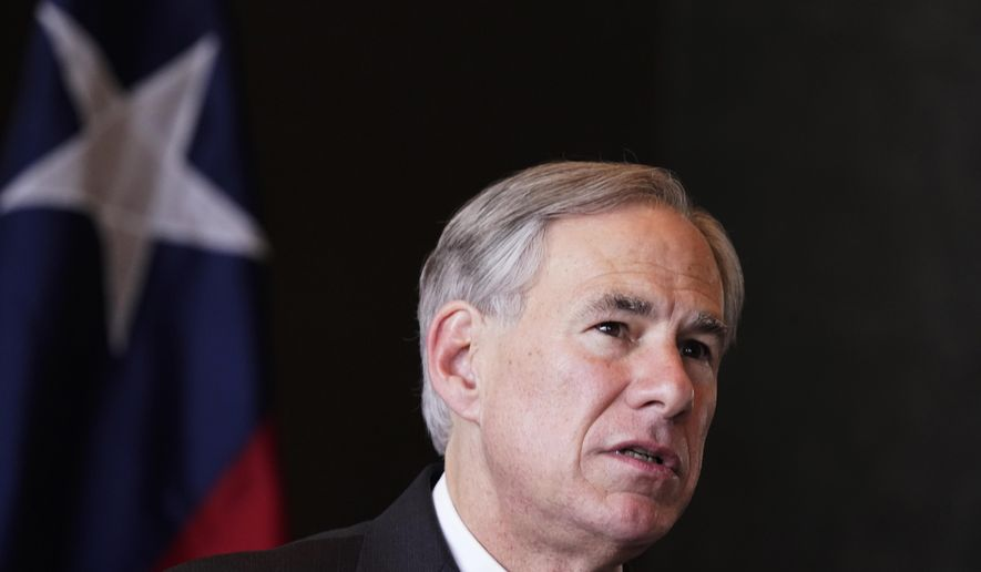 In this Wednesday, March 17, 2021, photo, Texas Gov Greg Abbott speaks during a news conference in Dallas. (AP Photo/LM Otero) **FILE**