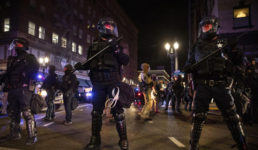 Lawmakers say they are making progress in finding an agreement on policing changes, including whether or not police officers should face civil lawsuits. (AP Photo/Paula Bronstein, File) **FILE**