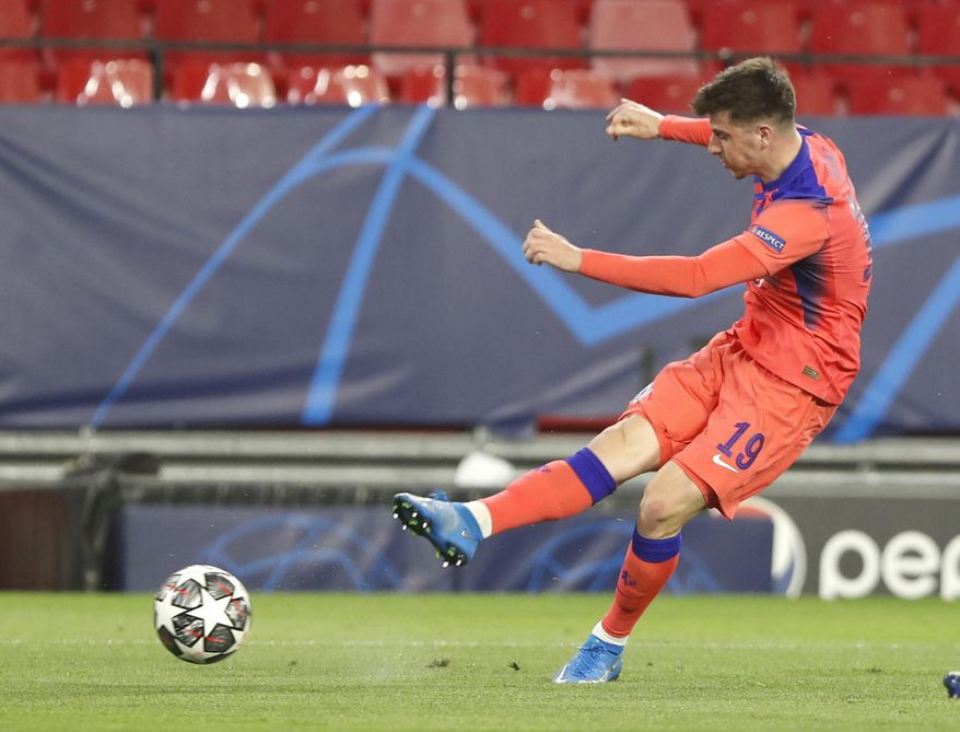 Chelsea's Mason Mount scores his side's opening goal during the Champions League, first leg, quarterfinal soccer match between FC Porto and Chelsea at the Ramon Sanchez-Pizjuan stadium in Seville, Spain, Wednesday, Apr. 7, 2021. (AP Photo/Angel Fernandez)