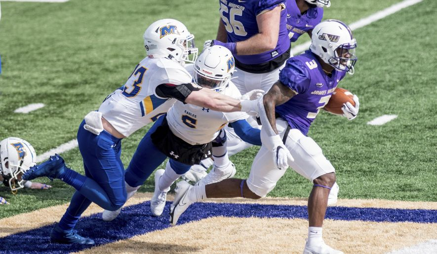 FILE - James Madison running back Solomon Vanhorse (3) breaks away from Morehead State defensive back Cooper Krezek (23) during the first half of an NCAA college football game in Harrisonburg, Va., in this Saturday, Feb. 20, 2021, file photo. James Madison remains solidly atop the STATS Perform FCS Top 25, but the Dukes could go into the playoffs on April 24 having played once in six weeks.(Daniel Lin/Daily News-Record via AP, File)