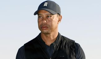FILE - In this Feb. 21, 2021, file photo, Tiger Woods looks on during the trophy ceremony on the practice green after the final round of the Genesis Invitational golf tournament at Riviera Country Club, in the Pacific Palisades area of Los Angeles. The Los Angeles County sheriff plans to announce Wednesday, April 7, 2021, what caused Woods to crash an SUV in Southern California earlier in the year, seriously injuring himself in the wreck. (AP Photo/Ryan Kang, File)