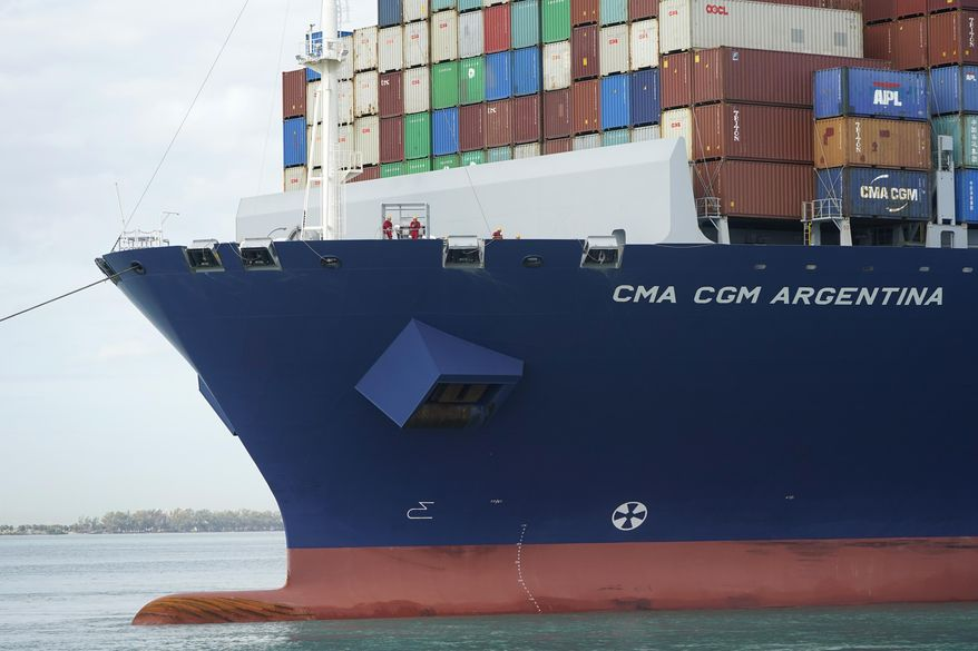 Crew members stand on the bow as the CMA CGM Argentina arrives at PortMiami, the largest container ship to call at a Florida port, Tuesday, April 6, 2021, in Miami.  The U.S. trade deficit grew to $71.1 billion in February, as a decline in exports more than offset a slight dip in imports. The February gap between what America buys from abroad compared to what it sells abroad jumped 4.8% the revised January deficit of $67.8 billion.vThe increase reflected a 2.6% decline in exports of goods and services to $187.3 billion on a seasonally adjusted basis. (AP Photo/Lynne Sladky)