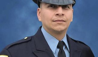 FILE - This undated file photo provided by the Chicago Police Department shows Chicago Police Officer Eduardo Marmolejo. Edward Brown, who fired a gun in 2018 that prompted Marmolejo and fellow Officer Conrad Gary to venture onto railroad tracks where they were fatally struck by a train, pleaded guilty Wednesday, April 7, 2021, to unlawful use of a weapon. (Chicago Police Department via AP, File)