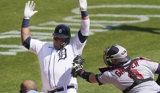 Detroit Tigers' Miguel Cabrera is tagged out by Minnesota Twins catcher Mitch Garver (8) as he tries to score from third during the sixth inning of a baseball game, Wednesday, April 7, 2021, in Detroit. (AP Photo/Carlos Osorio)