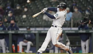 Seattle Mariners' Kyle Seager hits a three-run double during the sixth inning of the team's baseball game against the Chicago White Sox, Wednesday, April 7, 2021, in Seattle. (AP Photo/Ted S. Warren)