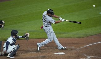 Chicago White Sox's Jose Abreu hits a grand slam during the eighth inning of the team's baseball game against the Seattle Mariners, Tuesday, April 6, 2021, in Seattle. (AP Photo/Ted S. Warren)