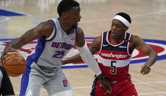 Detroit Pistons forward Tyler Cook (25) drives on Washington Wizards guard Cassius Winston (5) in the second half of a NBA basketball game in Detroit, Thursday, April 1, 2021. (AP Photo/Paul Sancya)
