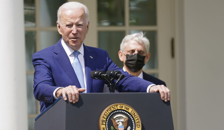 President Joe Biden, accompanied by Attorney General Merrick Garland, speaks about gun violence prevention in the Rose Garden at the White House, Thursday, April 8, 2021, in Washington. (AP Photo/Andrew Harnik)