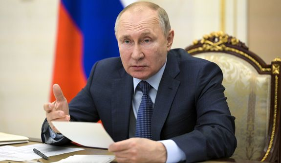 Russian President Vladimir Putin gestures while speaking during a cabinet meeting via video conference in Moscow, Russia, Thursday, April 8, 2021. (Alexei Druzhinin, Sputnik, Kremlin Pool Photo via AP)